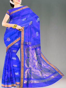Spread the charm in this blue color Mysore silk by cotton pattu saree. Seize the moment draped in this colorful extravaganza of zari and silver floral woven bootis with brilliant zari border and blue plain borders. A rich looking self color designer pallu with mango booti zari woven has hearts aflutter.