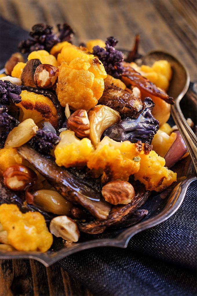 Warm fall salad made of roasted cauliflower, portobello mushrooms, red onions and hazelnuts - the perfect addition to your Thanksgiving table | www.viktoriastable.com