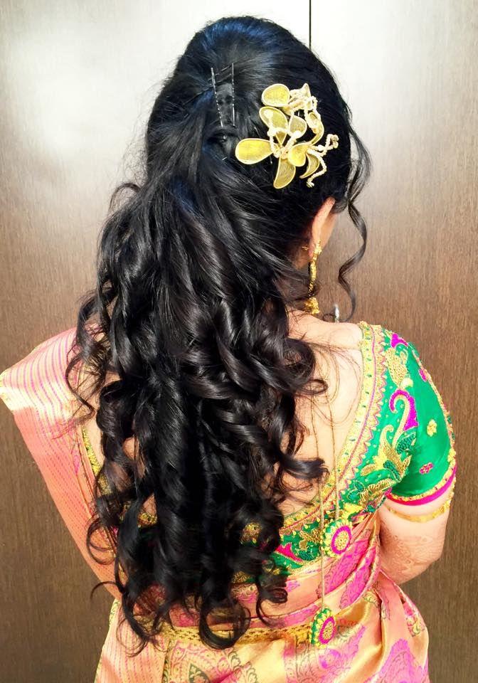 Indian bride's bridal reception hairstyle by Swank Studio. Find us at https://www.facebook.com/SwankStudioBangalore  #Saree #Blouse #Design