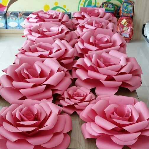 Giant paper roses! I like how these have a rose center, instead of the weird fringe center most patterns seem to have. No link to any pattern, but may be able to recreate on my own.