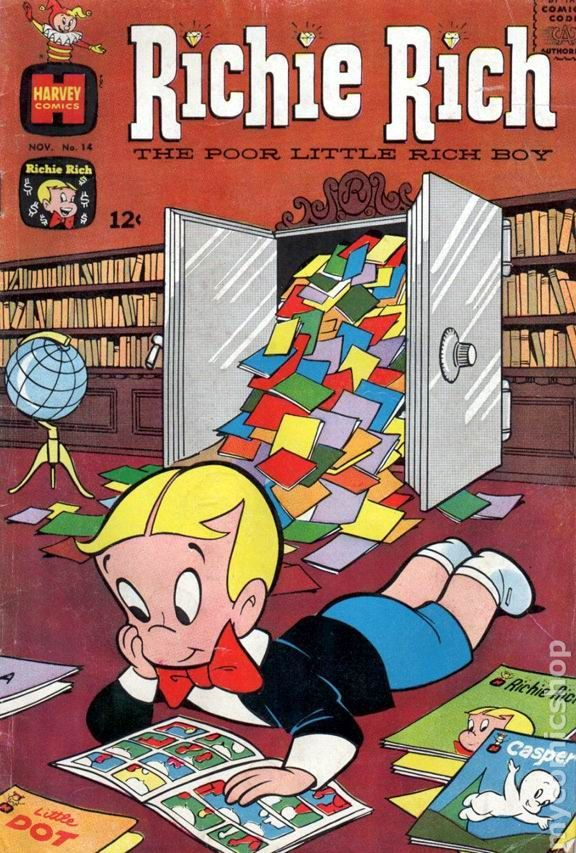 Richie Rich reads comic books from his stash,  #14 vintage Harvey comic boo cover.