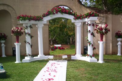 "White columns and wine-colored flowers are as classic as it comes. <a target=""_blank"" href=""http://www.mullinsrentals.com/products.php?cat_id=22"">Mullins Special Occasions</a> via <a target=""_blank"" href=""http://www.pinterest.com/pin/73676143877839830/""> Pinterest</a>."