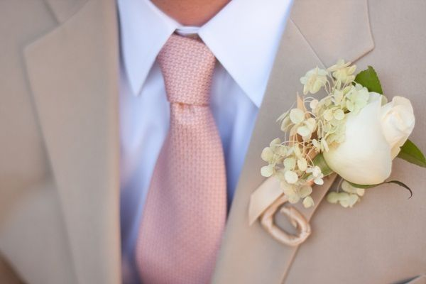 I think I like this suit and tie on the groom.. would go nice with a cream wedding gown and blush bridesmaid dresses