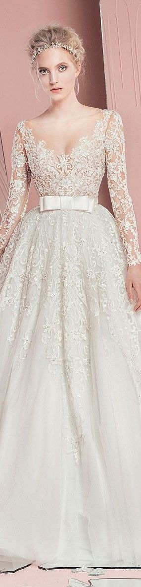 Love all of the lace and the bow, and the sleeves. I just wish the neck line was a little higher