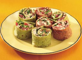 Italian BLT Pinwheels - easy roll-ups, with flavored tortillas cradling cream cheese, bacon, and tangy sun-dried tomatoes.
