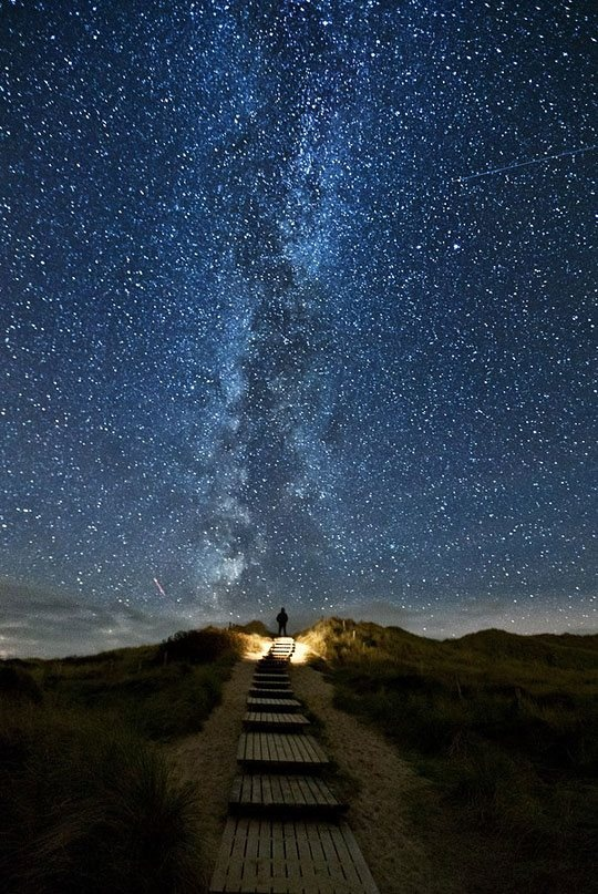 The Milky Way, shot from the North Sea coast. A trail into space? Or the stairway to heaven. You can see a shooting star in this too :D  http://www.gold-boat.com/heavens-boat/