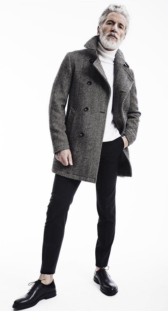 Shop this look on Lookastic:  https://lookastic.com/men/looks/grey-overcoat-white-turtleneck-black-chinos/14974  — White Turtleneck  — Grey Herringbone Overcoat  — Black Chinos  — Black Leather Oxford Shoes