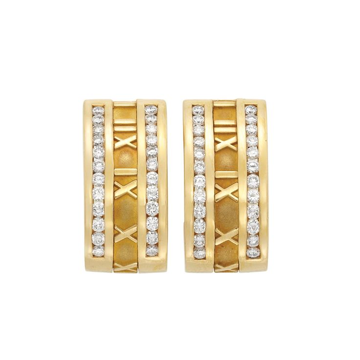 Pair of Gold and Diamond 'Atlas' Hoop Earclips, Tiffany & Co.  18 kt., the gold hoops centering a line of polished gold Roman numerals, edged by 48 round diamonds approximately 1.55 cts., signed Tiffany & Co., Italy, 1995