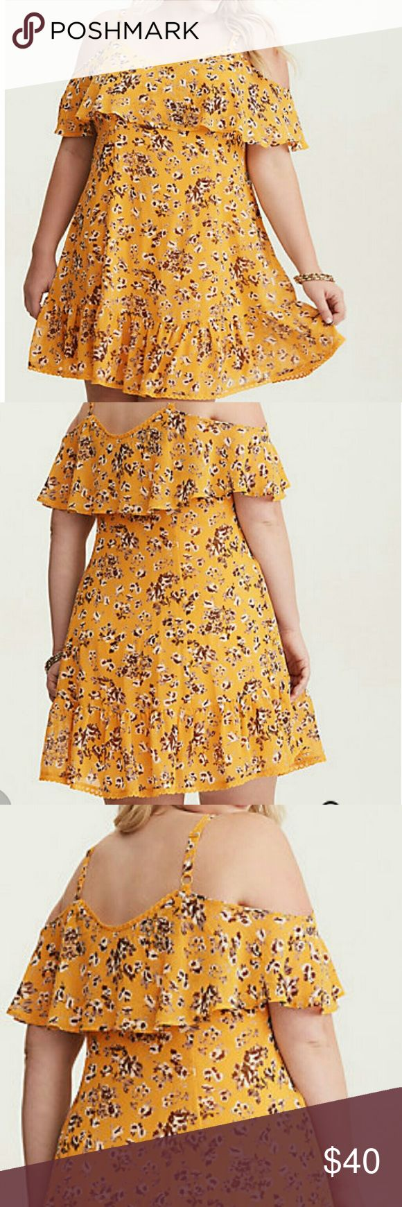 Torrid Brand New Super Cute Dress Brand New Yellow Floral Print Chiffon Cold Shoulder Trapeze Dress. A flounce overlay on the bodice lends delicate, floaty quality, with lace trim and a ruffled hem offering flirty appeal.  Chiffon fabric V-neck flounce neck  Cold shoulder sleeves No waist Mini length  Torrid Size 00 which is a Large torrid Dresses Mini
