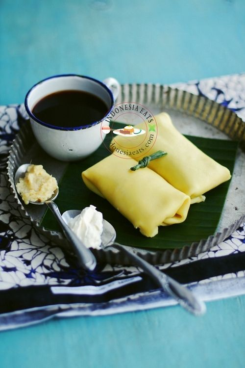 Durian Pancake is a popular dessert in 3 Southeast Asian countries, Indonesia, Malaysia and Singapore.  I don't know why it's called Pancake while the shape is similar to Crêpe that is filled and fold like an envelope. The Indonesian dark coffee (kopi tubruk) would be perfect to company this dessert.
