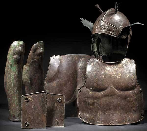 Set of Greek armour with an attic Chalcidian helmet, cuirass, and long greaves. 5th/4th century B.C.E.