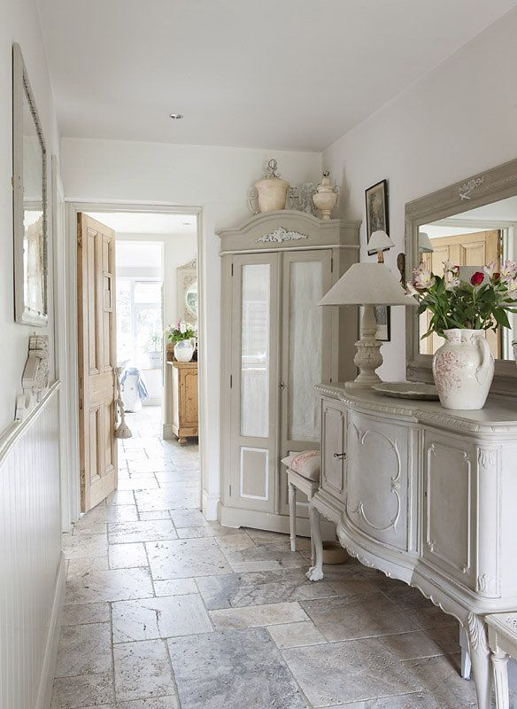 Chic French-style charm brings life to this otherwise lonely hallway