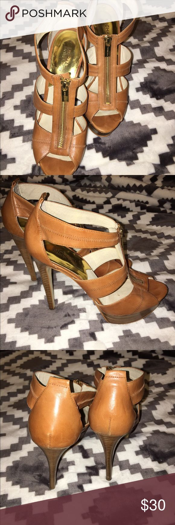 Michaels Kors Heels 9.5 Beautiful luggage leather MK heels in excellent condition! Other MK items in my closet...discount with bundle. Michael Kors Shoes Heels
