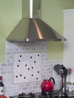 Under the Hood — Install an oven range hood to upgrade your kitchen's exhaust system.