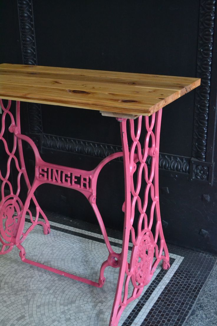 Vintage Singer Table base transformed into a hall table using salvaged floor-boards