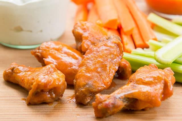 Crispy Baked Buffalo Chicken Wings With Celery Sticks Carrot Sticks And Blue Cheese Dip Baked Chicken Crispy Baked Chicken Wings Baked Chicken Wings