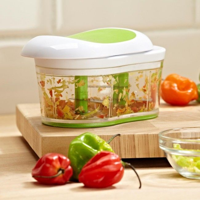 The Slip Herb & Vegetable Chopper is great for mincing fresh herbs, chopping garlic or making fresh salsa. Just slide the lid back and forth to spin the stainless steel chopping blades, it's that easy!