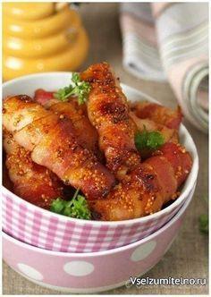 """Курица в беконе   Ингредиенты:  большая куриная грудка (около 700г) упаковка сырокопченого бекона (400 г - 20 полосок) По 1ст.л. зерновой горчицы и обычной (не """"злой"""") 1 ст.л. жидкого меда 2 ст.л. сока лимона перец - по желанию  Приготовление:  Так как готовка занимает 5 сек, то заранее включите духовку на 220 оС. Мясо нарезать полосками по длине грудки, толщиной с палец. Плотно обмотать каждую полоску беконом. Выложить полоски в форму для запекания (смазывать форму не нужно). Смешать мед…"""