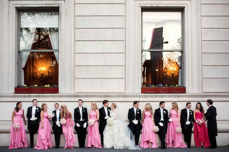 The bride and groom were joined by elegant bridesmaids in floor-length pink gowns and groomsmen wearing long-tail tuxedos with white bow ties and gloves. #bridesmaids Photography: Michael Falco for Christian Oth Studio. Read More: http://www.insideweddings.com/weddings/formal-manhattan-wedding-with-opulent-ballroom-decor/517/