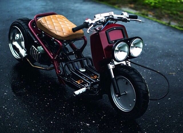Honda Ruckus cusom with tubular frame, twin headlights, diamond-stitched tan leather seat and red-wine colored paint job