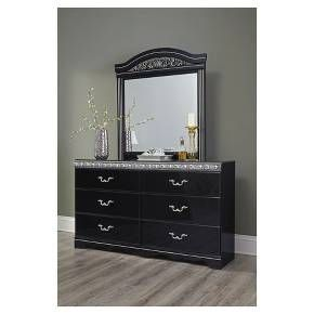 It's hard to say what stands out most about this dresser. Its glossy finish, metallic scroll moulding, faux marble top and intricate handles are all shining stars. A bright addition to traditional or Hollywood regency decor. Signature Design by Ashley is a registered trademark of Ashley Furniture Industries, Inc.