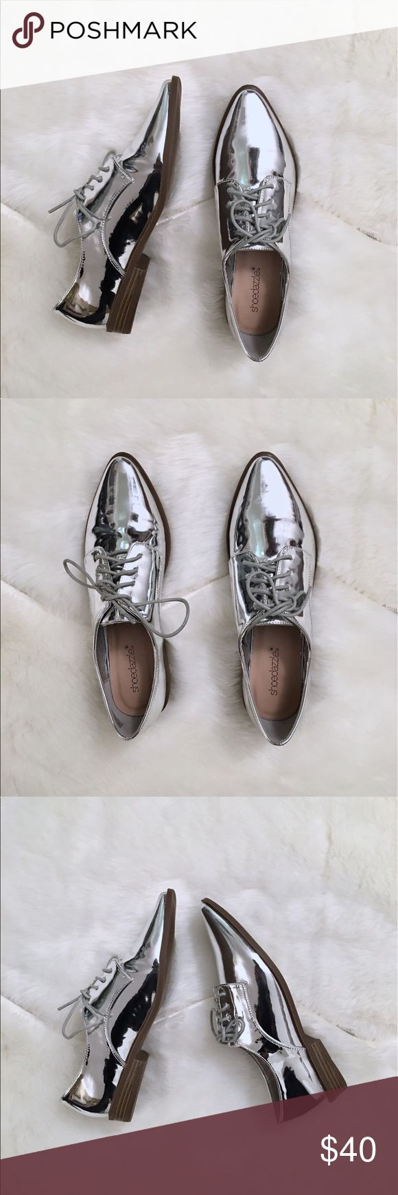 """New Silver Oxfords New in box. Extremely edgy and stylish silver oxford pointed toe shoes in excellent condition. Perfect for the spring and summer. They are  from a smoke free and pet free clean home.  Overview:  ♡  Faux patent  ♡ Front Lace closures  ♡ Outside heel height: 1""""   ♡ True to size Shoes"""