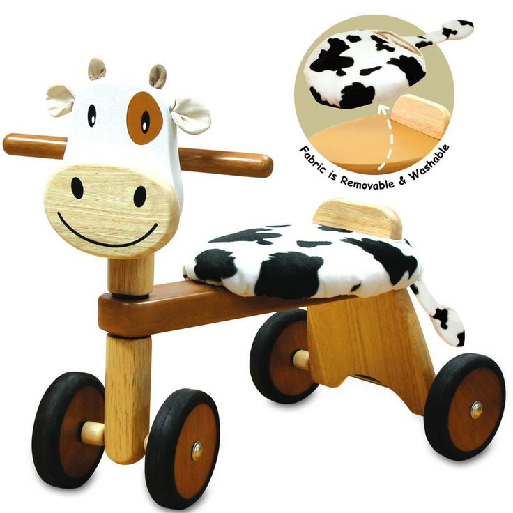 A ride-on cow features a sturdy wooden trike  with a comfortable seat. Cushion is removable and washable.   Produced from sustainable rubber wood and finished with non toxic child safe paints and laquers.