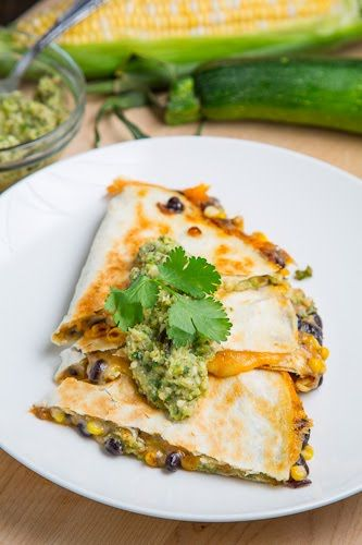 Corn and Black Bean Quesadillas with Roast Zucchini Salsa ~ You really cannot go wrong taking the sweet caramelized corn along with the creamy black bean and the fresh and tasty zucchini salsa with a nice spicy heat and wrapping them all in a toasted golden brown tortilla along with plenty of melted cheese!