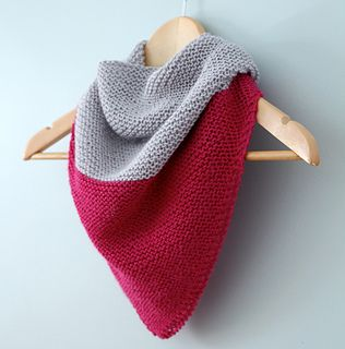 Colorblock Shawl is a fun twist on a classic triangular shawl. It is worked in one piece from the bottom up in solid, contrasting colors. It is a great beginner pattern, using simple increases to create the triangular shape.