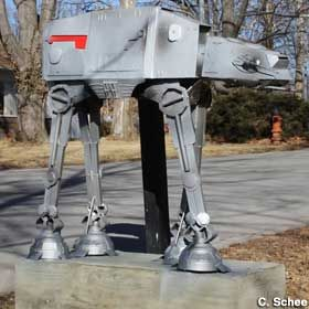 "Kansas City, Missouri - Star Wars ""At-At Walker"" Mailbox This is a replica of an At-At Walker from Star Wars, which is also a mailbox! Beautifully designed and welded.  [C. Schee, 02/08/2014]  C. Schee adds that, ""Jason made this mailbox after a drunk driver took out the original,"" and that it's anchored ""with six feet of rebar and 500 pounds of concrete. It's not going anywhere if another driver hits it."""