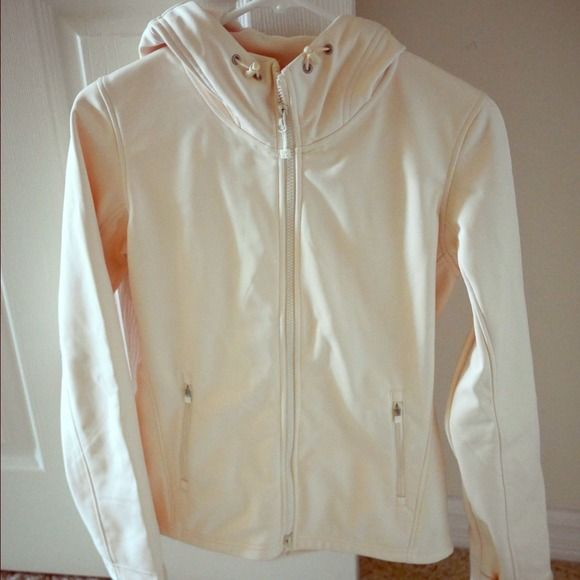 Uniqlo jacket off white cream sz M fits like small Brand new uniqlo jacket purchased from japan.  It says size M but it fits like a small.  Soft inside, water repellent outside.  Hooded, makes it look very sporty! Open to offers UNIQLO Jackets & Coats