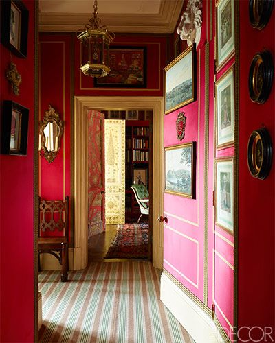 Alidad's London apartment ~ In the hallway of interior designer Alidad's London apartment, the brass lantern is antique, the neo-Gothic chair is English, the walls are lined with suede and braid work