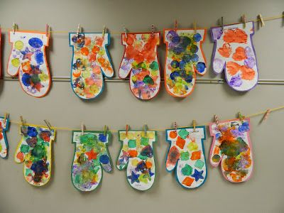 sponge painted mittens hanging on a clothesline