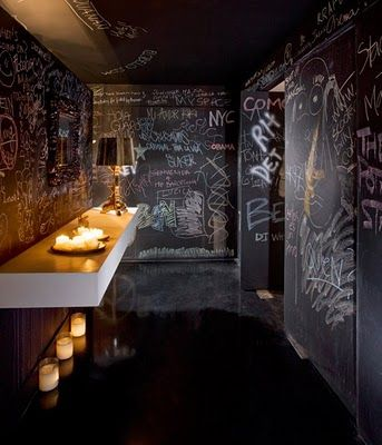Perfect idea for a playroom or game room for kids.  Seriously, with floor-to-ceiling chalkboard paint and tons of chalk, I think I myself would be occupied for hours, not to mention any future kids.