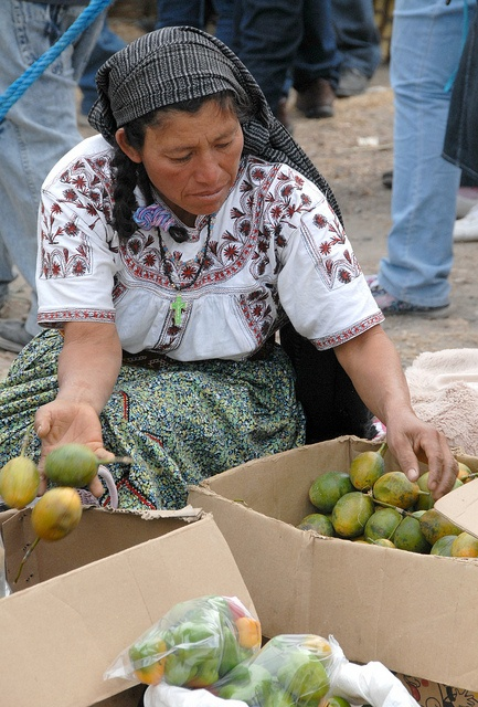 Mixe Woman - Oaxaca, Mexico. This Mixe woman is selling fruit at the site of a religious pilgrimage. She comes from the community of Tlahuitoltepec (Tlahui) in northern Oaxaca. All Rights Reserved © 2012 Thomas Aleto