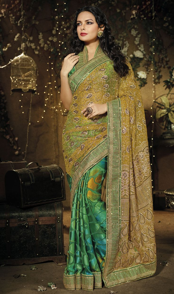 Green Net & Brasso Saree....with Sequince, Zari Embroidery and Patch patta Work.