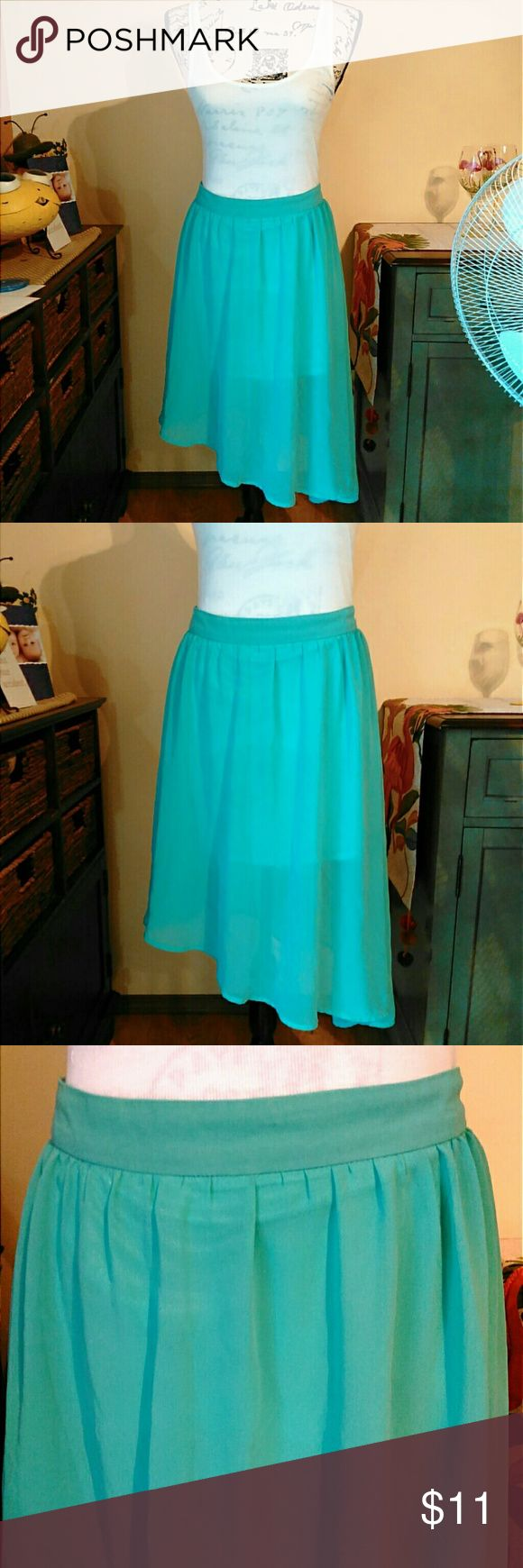 Turquoise Midi Skirt Soft and light turquoise shirt, hangs longer on one side. Keep in mind that forever 21 runs kind of small. 100% polyester. Measurements upon request! Forever 21 Skirts Midi