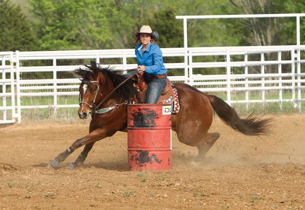 Size Matters: To win at barrel racing, you must be able to adjust your ride and your horse's run to any size of pen. Here's how.