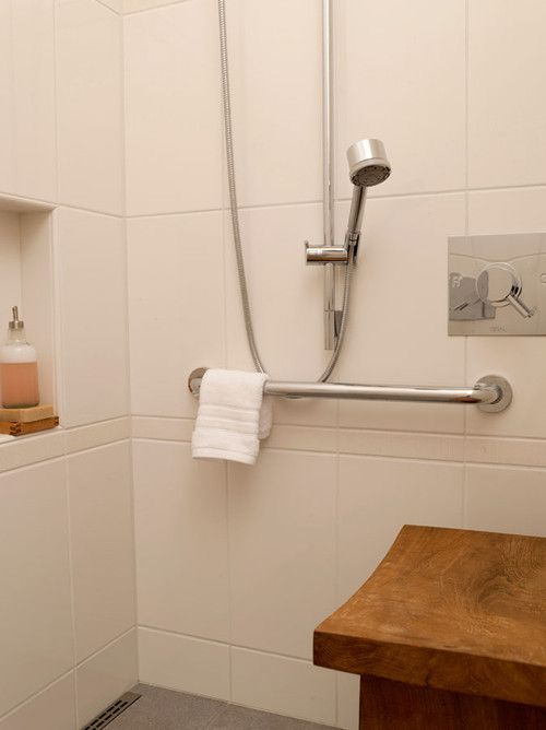 Bathroom safety tip: Add a bench in the shower for a lowered risk of falling. Shower grab bars are necessary for bathroom safety. #DiaryofaDIYer
