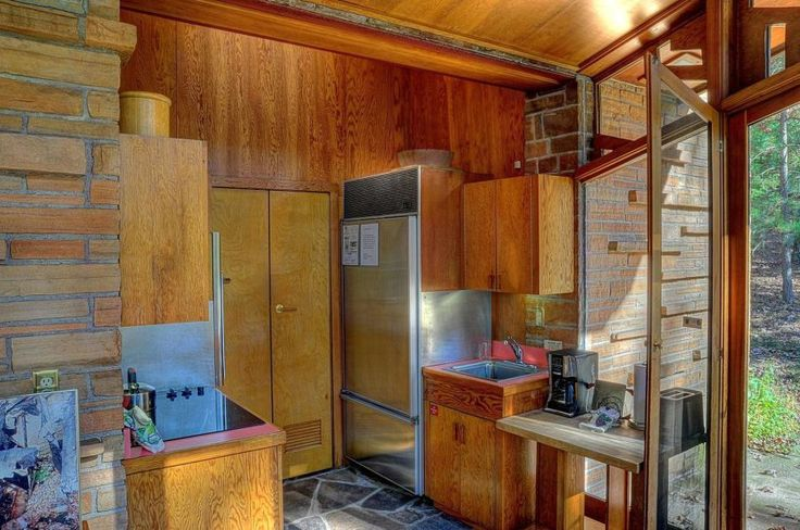 Welcome to the Seth Peterson Cottage | A 1958 Frank Lloyd Wright Masterpiece - the guy understood that the fridge and the range do not belong next to each other!!!! A refer door opening into a doorway.... well that's another story.