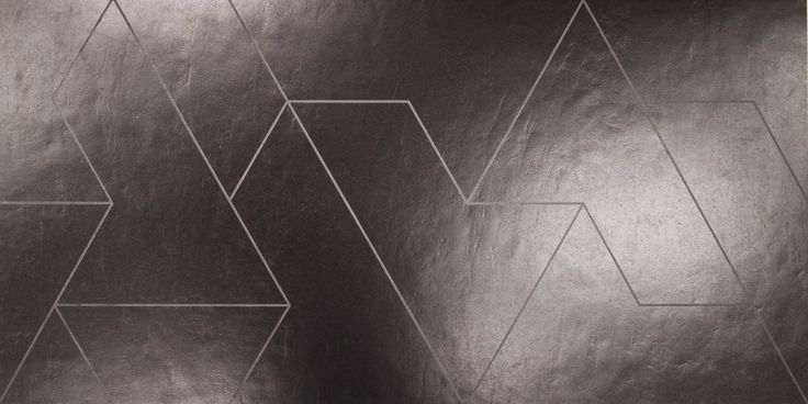 Il progetto sviluppato da Daniel Libeskind, esplorando i canoni dell'architettura parametrica, si estende su una superficie di 1000 metri quadrati. La costruzione ha richiesto la messa in opera di oltre 140 tonnellate di acciaio per le strutture e circa 4200 lastre di grès porcellanato della serie Fractile, disegnate dall'architetto secondo un'esclusiva matrice tridimensionale.