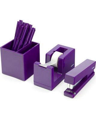 Purple office desk supplies, stapler, tape dispenser and pencil holder