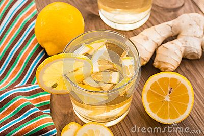 Glass with a lemon-ginger cool drink