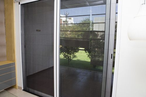 Mosquito+net+Barrier+Free+Door+Fitment+:+A+great+solution+for+huge+openings.+This+sliding+door+fitment+rolls+on+a+thin+plastic+strip+that+hardly+obstructs+movement+of+people.+An+advanced+fitment+option+for+premium+homes+and+interiors,+it+adds+sophistication+to+the+atmosphere+it+is+used+and+effectively+stops+mosquitoes+or+insects+into+the+living+area.+It+has+the+option+to+use+a+single+shutter+or+twin+shutter+opening. Application:+Doors  Mesh+Options:  Fibre-Glass…