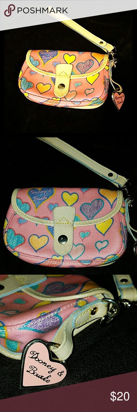 Dooney & Bourke pink heart wristlet Authentic dooney & bourke. Super adorable pink with colorful heart pattern wristlet. Pink and gold heart key chain on side. Leather strap. Clean inside. Used but in great condition. Snap dront closure. Bundle and save. Offers always welcomed. Pet free smoke free home. See pics for details 🤗 Dooney & Bourke Bags Clutches & Wristlets