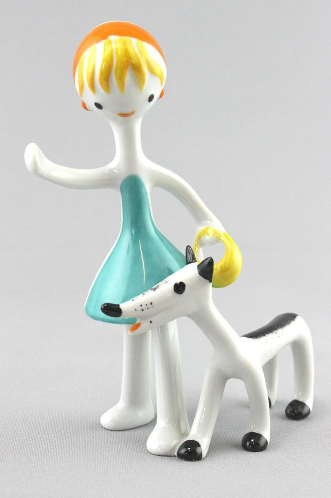 A Hollohaza figure of a woman and dog. Hungarian midcentury design
