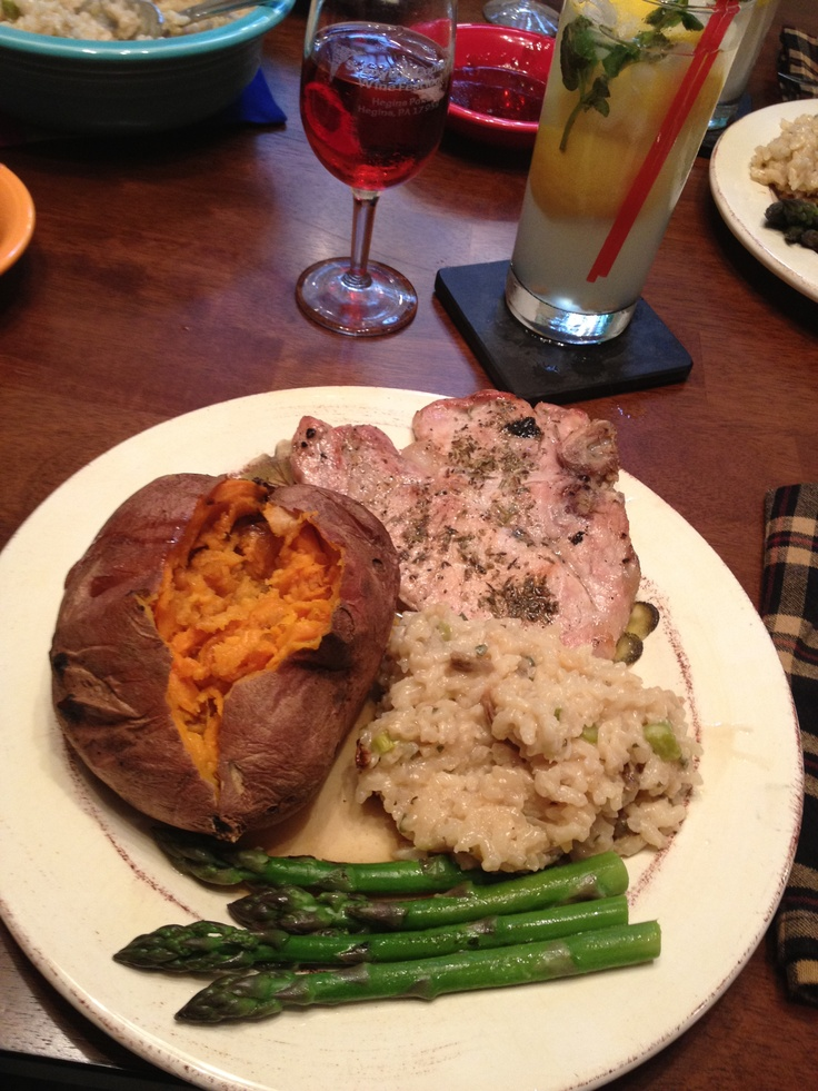 Grilled pork chop, asparagus risotto, and baked sweet potato