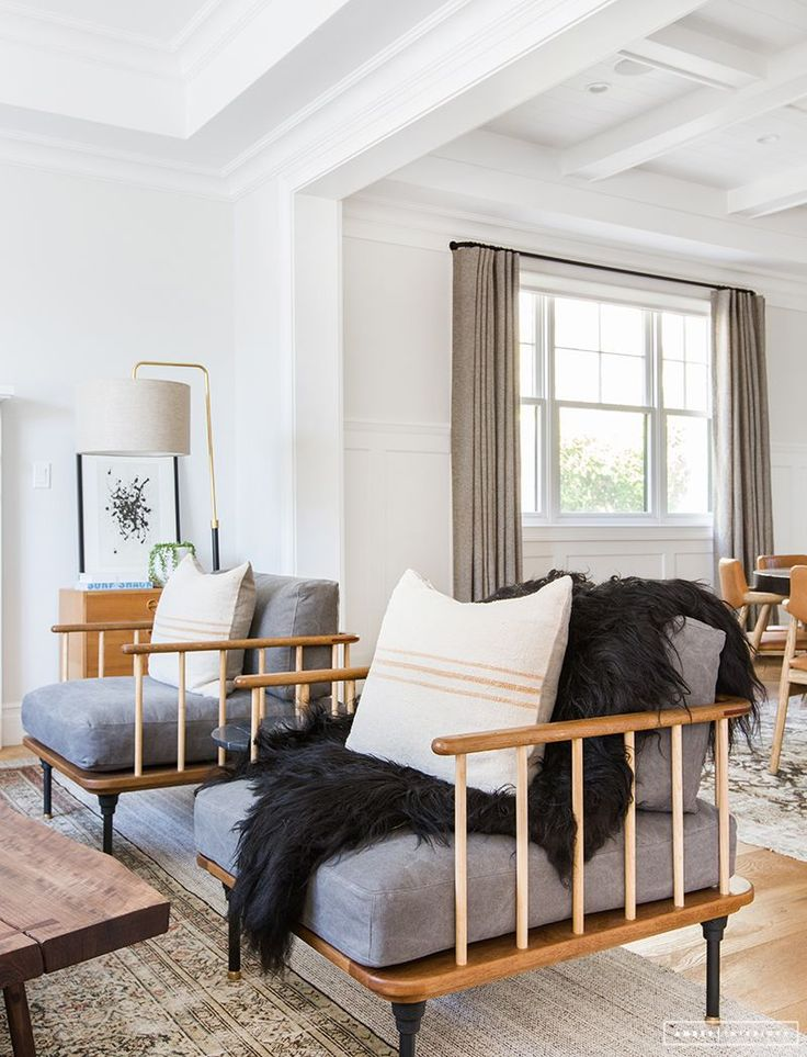black sheepskin throw to add contrast to a neutral room
