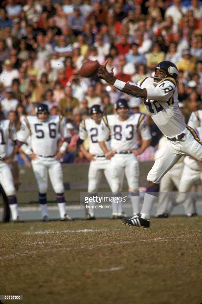 Wide receiver John Gilliam #42 of the Minnesota Vikings stretches for a pass against the Los Angeles Rams at the Los Angeles Memorial Coliseum on November 17, 1972 in Los Angeles, California. The Vikings defeated the Rams 45-41.