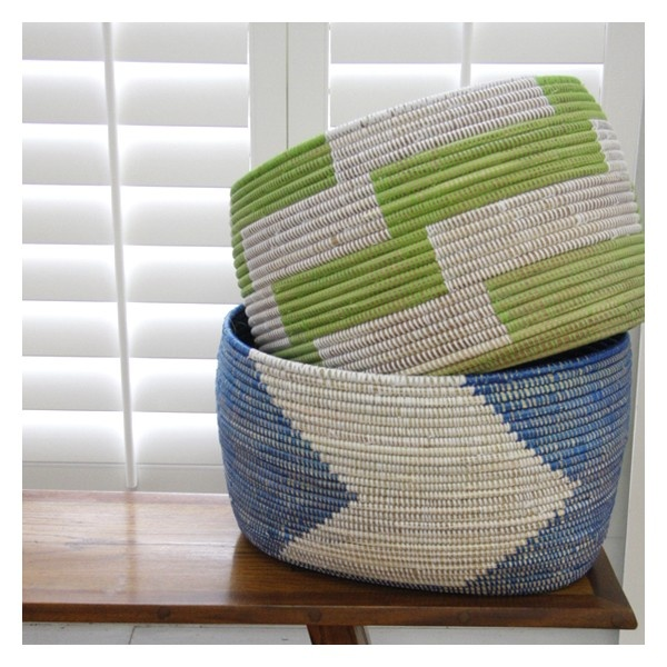 These beautifully simple African baskets represent modern African home decor done right. Woven by Wolof women from plastic strips used to make bazin mats and abundant typha stalks (cattails), these baskets offer versatile functionality